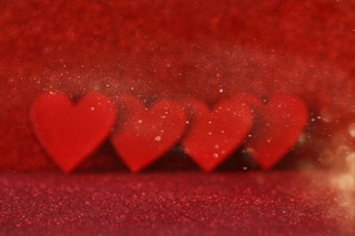 wooden-red-hearts-on-red-shiny-background