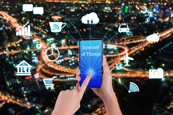 woman-hand-using-smart-phone-in-concept-internet-of-things-with-night-modern-city-background