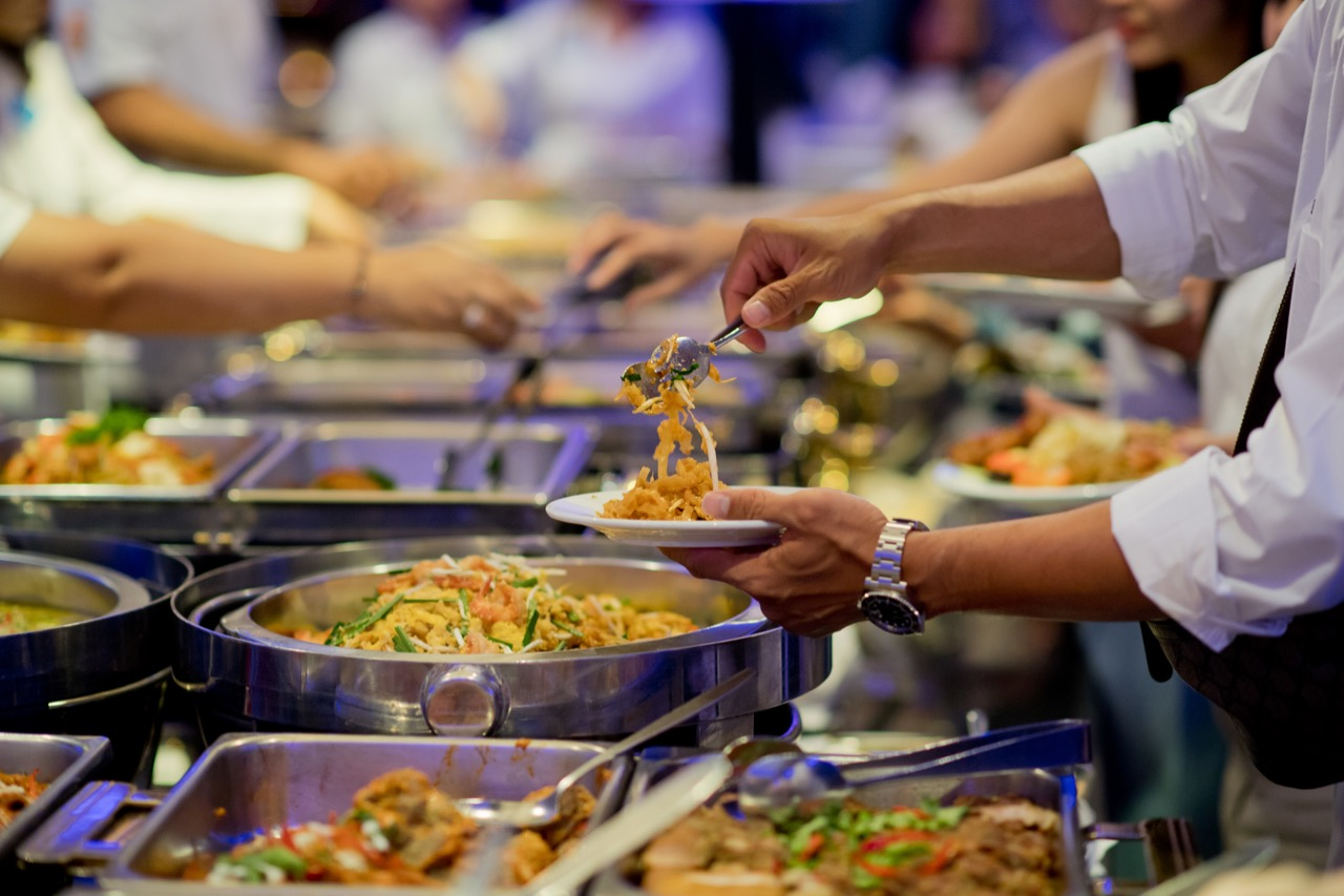 scooping-the-food.-buffet-food-at-restaurant.-catering-food