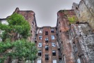 facade-of-ruined-old-vintage-red-brick-ghetto-house-at-kamienico--part-of-former-jewish-ghetto--warsaw-city--poland---hdr--high-dynamic-range--image