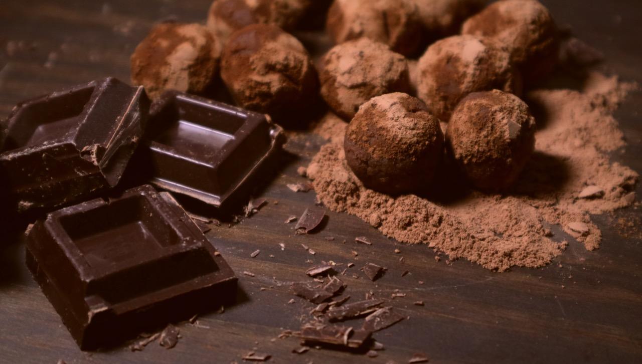chocolate-truffles-and-dark-chocolate-on-rustic-dark-wooden-background