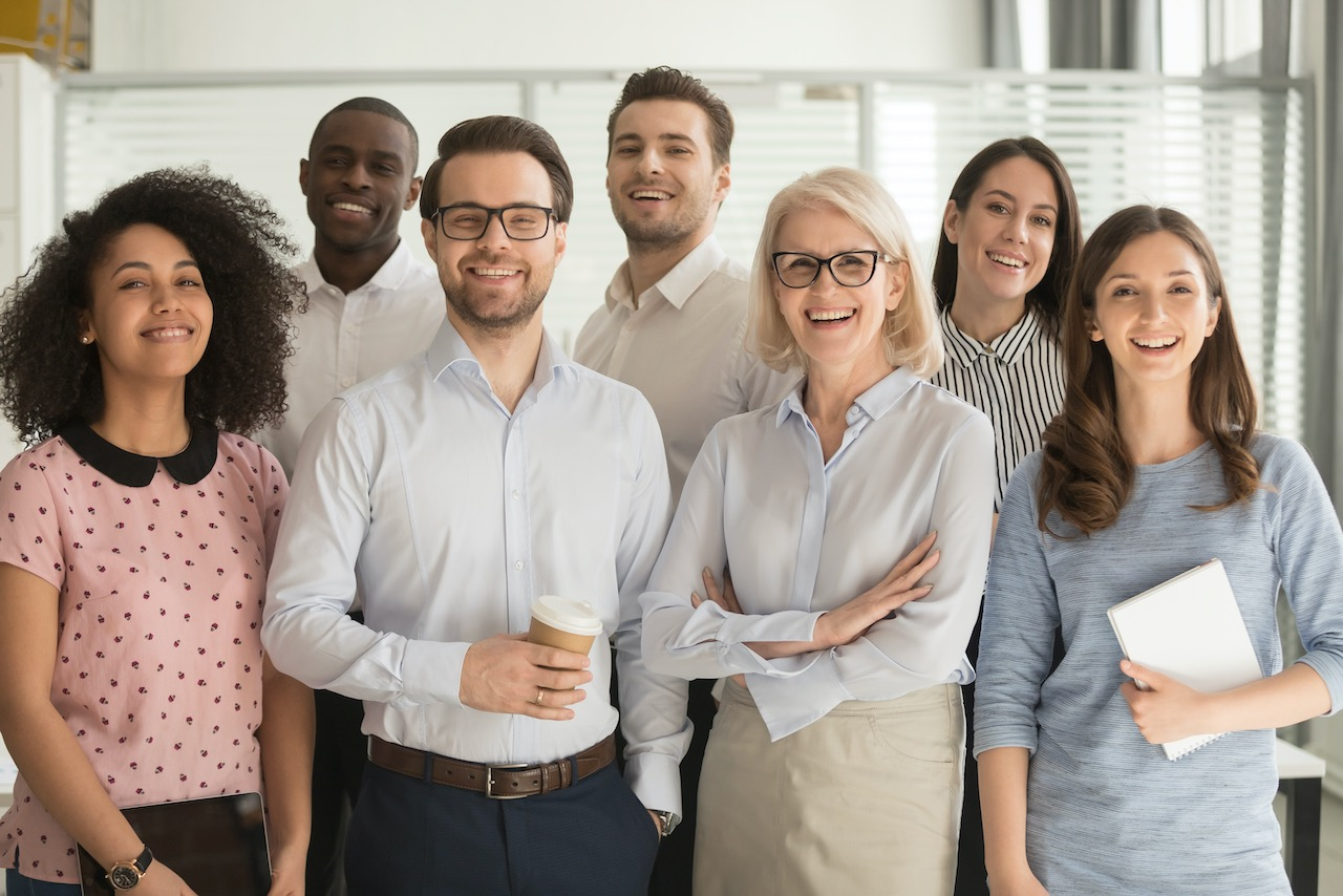 smiling-diverse-employees-posing-for-photo-in-office