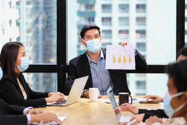 executive-team-meeting-during-coronavirus-or-covid-19-for-business-new-financial-strategy-after-pandemic-with-all-staff-members-wearing-facial-mask-as-of-new-normal-and-social-distancing-policy