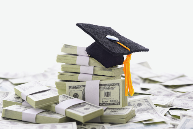 mortarboard-on-a-pile-of-money-representing-the-high-cost-of-higher-education-and-bribery