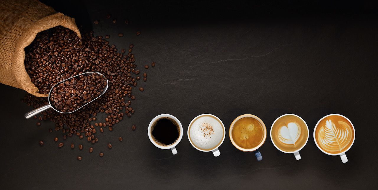 variety-of-cups-of-coffee-and-coffee-beans-in-burlap-sack-on-black-background