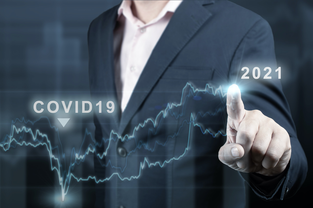 concept-of-economic-recovery-after-the-fall-due-to-the-covid-19-coronavirus-pandemic.-financial-graph-2021.-stock-market-chart.-businessman-pointing-graph.-return-of-growth-after-a-fall