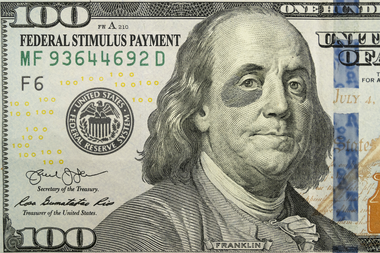 this-brand-new-one-hundred-bill-and-ben-franklin-with-a-black-eye-tell-an-economic-story.-the-added-text-of-federal-stimulus-payment-explains-the-economic-support